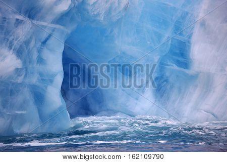 Ice cave in beautiful iceberg