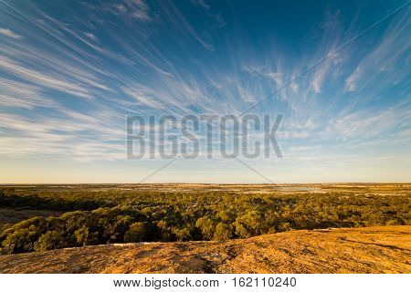 The scenery on the top of the wave rock Hyden Western Australia sunset scene .