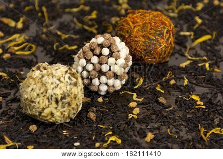 chocolate balls coated in nuts and spices confectionary sweets