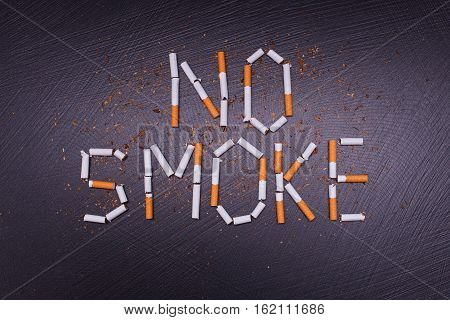 anti tobacco poster on dark stone background