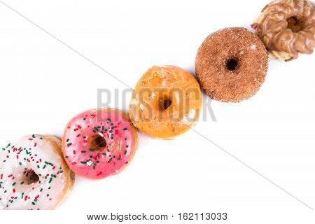 Frosted Donut Lineup Shallow Depth Of Field Isolated On A White Background