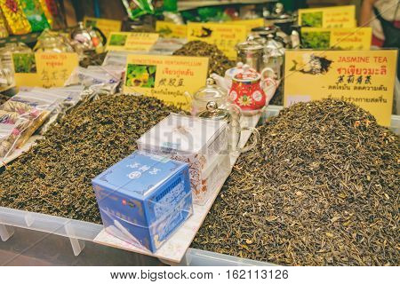 Bangkok, Thailand - December 21, 2015: Boxes with various sorts of chinese dried tea with price tag chinese tea shop on the Tea Market in Chinatown district, Bangkok, Thailand