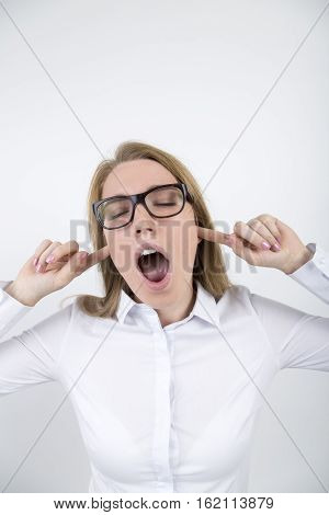 Blond Girl In Glasses With Fingers In Ears