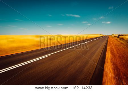 Asphalt road located on south Western Australia . Motion blurred.