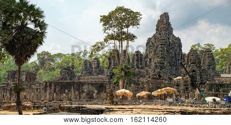Siem Reap, Cambodia - February 2, 2016: Worker renovate Bayon temple. Ancient Khmer architecture for restoration. Prasat Bayon is the central temple of Angkor Thom Complex, Siem Reap, Cambodia.