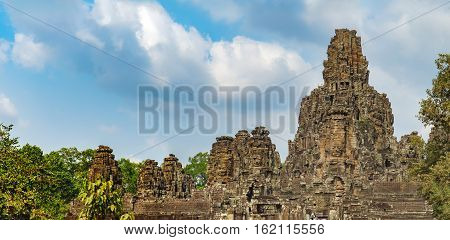 Prasat Bayon with smiling stone faces is the central temple of Angkor Thom Complex, Siem Reap, Cambodia. Ancient Khmer architecture and famous Cambodian landmark World Heritage.