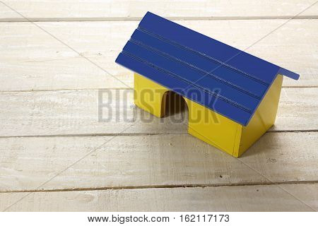 Toy Wood Block House on Wooden Background