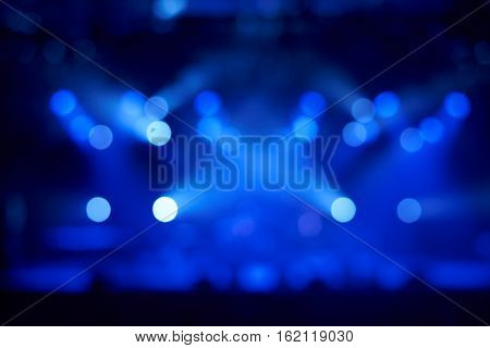 Blurred concert blue lights on stage. Night music live concept. Advertising of perfomance.