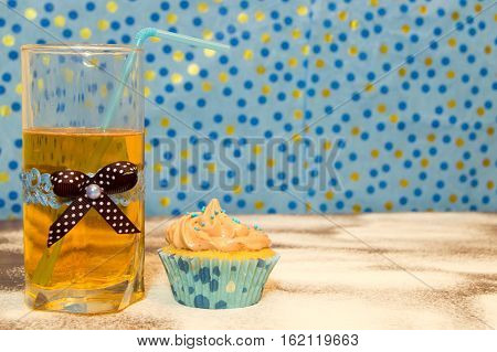 cake and a glass of water on the wooden background