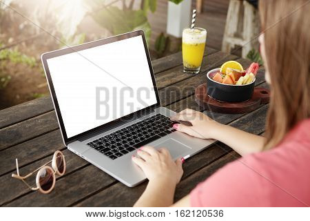 People, Technology And Communication. Female Blogger Working On New Post On Her Blog, Sitting In Fro