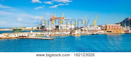 harbor port of Ancona, Italy with ships and cargo cranes