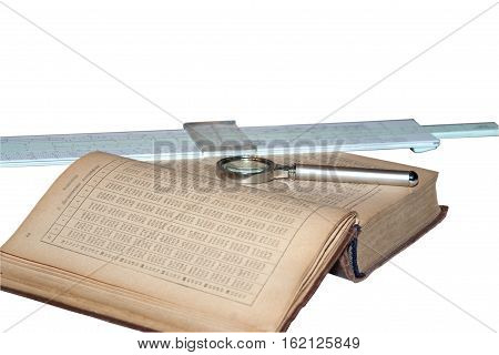 Handbook of mathematics magnifying glass and a slide rule isolated on white background Old items for study and work