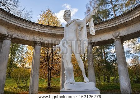 pavilion Apollo Colonnade with statue of Apollo Belvedere - roman marble copy of a bronze original of ancient Greek sculptor Leohara in Pavlovsk Park, Saint Petersburg, Russia