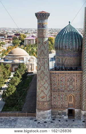 Samarkand. Top view of a minaret and the dome of Sher-Dor madrasah Registan
