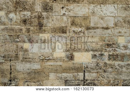 Old corroded running bond stone wall background