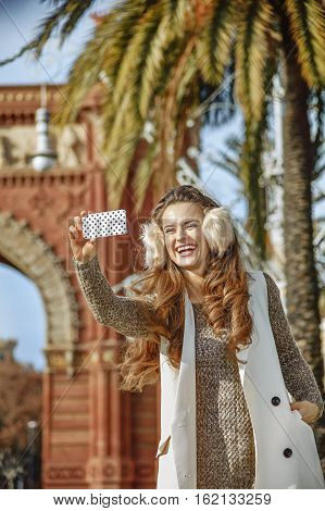Fashion-monger Near Arc De Triomf Taking Selfie With Cellphone