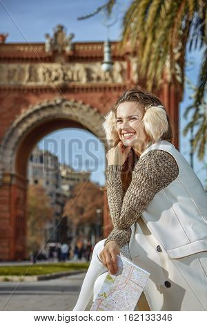 Happy Trendy Woman In Earmuffs In Barcelona, Spain With Map