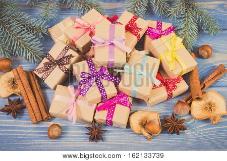Vintage Photo, Wrapped Gifts With Ribbons For Christmas, Spices And Spruce Branches