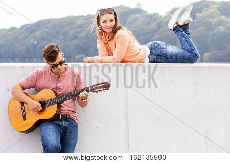 Guitarist And His Muse.