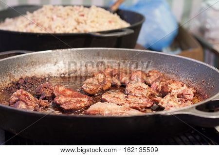 Fried Meat In A Pan At Christmas Market