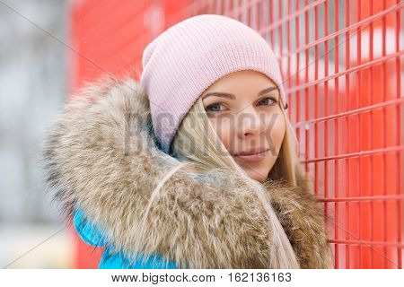 Cloudy Outdoor Winter Portrait Of Young Happy Adorable Woman In Bright Cyan Coat Posing In Winter Ci