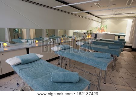 Hobart Australia-July 20 2011. Interior view of a teaching facility for beauty and masage therapies showing a row of massage tables.