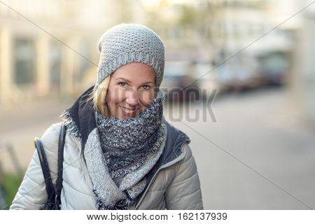 Smiling Young Woman In A Stylish Winter Outfit