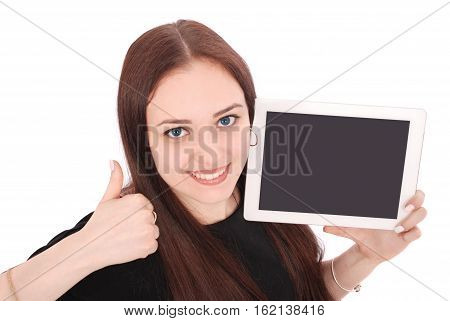 Happy student teenage girl with tablet pc. Sitting sideways and holding thumb up. Isolated on white