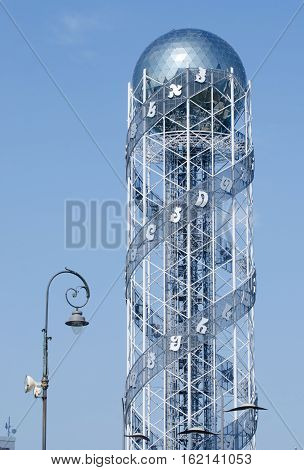 BATUMI ,ADJARA,GEORGIA - OCTOBER 7: Alphabetic Tower located on seaside on October 7 2016 in Batumi ,Georgia.Tower symbolizes the uniqueness of Georgian alphabet and holding 33 letters each of 4 meters height