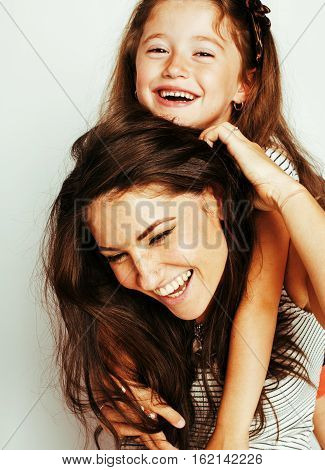 bright picture of hugging mother and daughter happy together, smiling stylish family. lifestyle people concept close up