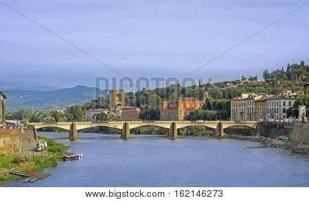 The Ponte alla Carraia Bridge is a five-arched bridge spanning the River Arno and linking the district of Oltrarno to the rest of the city of Florence Italy.