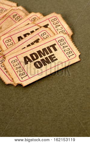Old tickets admit one pile on brown paper