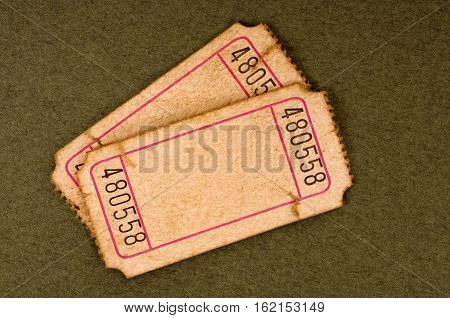 Old blank tickets torn stub on brown background