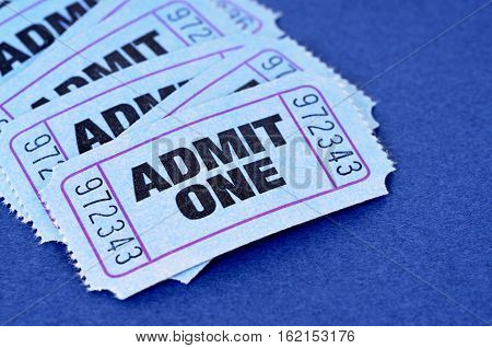 Admit one tickets several on blue background