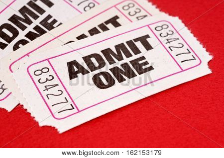 Admit one tickets lots on red background