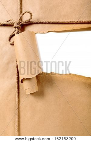 Torn brown paper package background white ripped strip