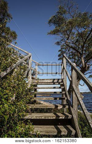 Wooden stair with scene view on Coalmine Beach Walpole Australia . vintage toning filter add .