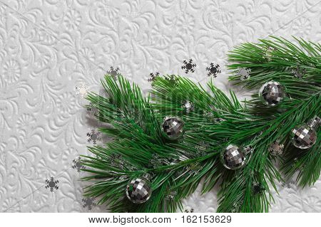 Fir tree with silver christmas toys and snowflakes on the white background
