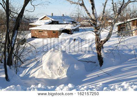 Winter. Winter landscape. Rural landscape. Rural house. Shade on snow.