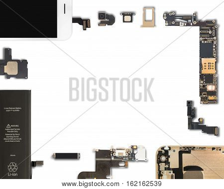 Flat Lay (Top view) of smartphone components isolate on white background with copy space and clipping path in 5:4 aspect ratio
