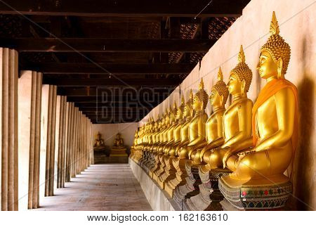 Row of sacred Buddha images in Putthaisawan Temple located at Ayuttaya Province Thailand
