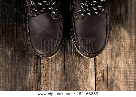 Brown genuine leather boots close up. Winter boots