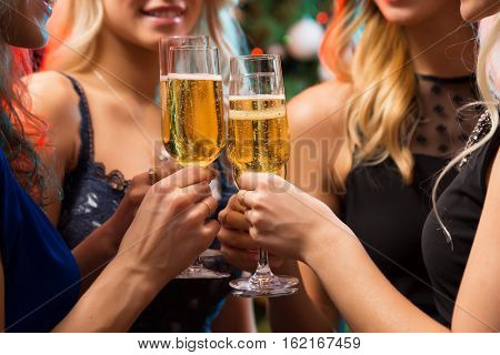 Happy young women with glasses of champagne. X-mas.