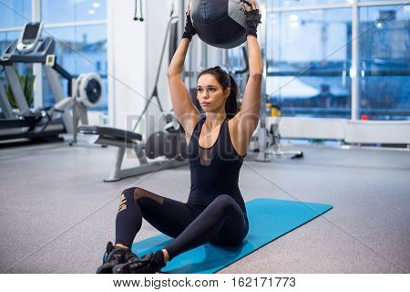 Work out fitness woman doing sit ups abs abdominal crunches core exercises with medecine ball poster