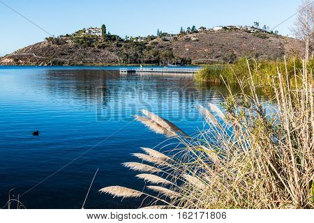 Lake Murray reservoir and floating fishing pier as part of Mission Trails Regional Park in San Diego, California.