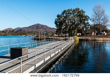 Fishing pier at Lake Murray in San Diego, California with Cowles Mountain in the background.