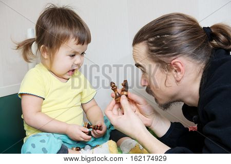 Father And Daughter Playing, Dad Teaching Child Chess Figure