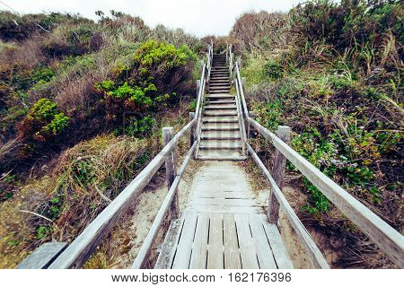 Steps leading down to beach at Torndirrup National Park Albany Western Australia Australia.vintage toning filter add .