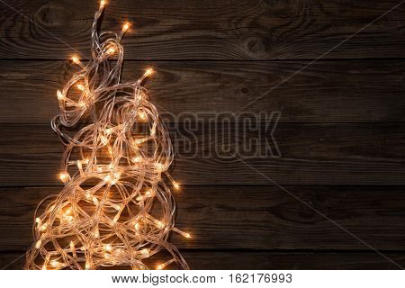 Glowing festoon on brown background,
