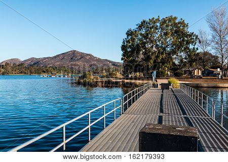 Fishing pier at Lake Murray with Cowles Mountain in the background in San Diego, California.